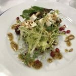 Goat cheese salad with pine nuts and cured artisan quince vinaigrette